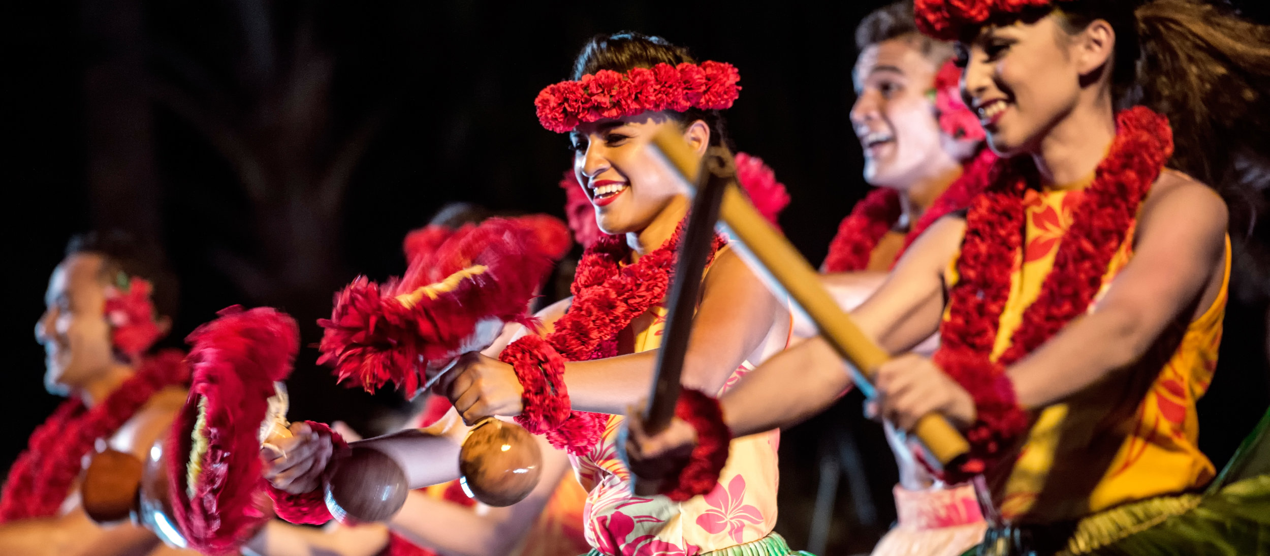 aulani-activities-ka-waa-luau-close-up-dancers-in-red-16x7.jpg