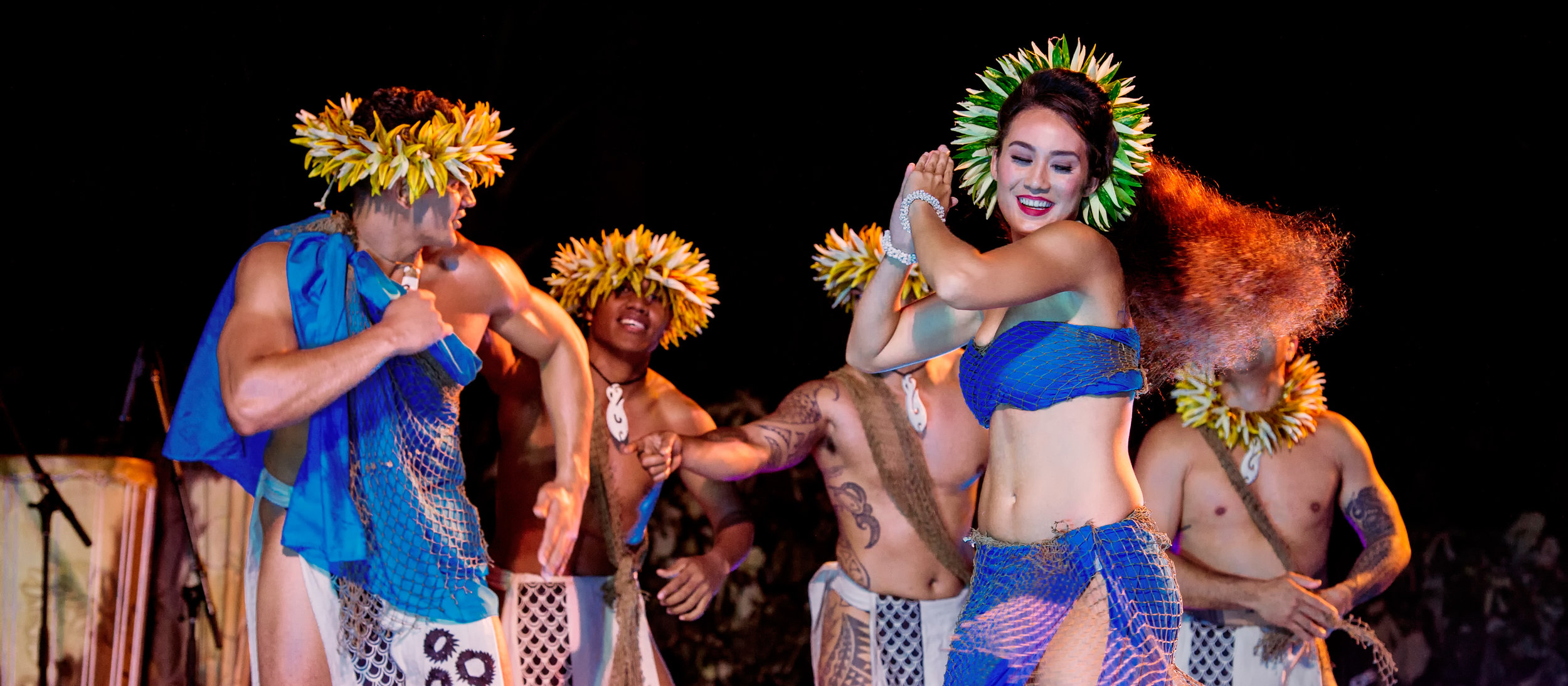 aulani-activities-ka-waa-luau-2-dancers-in-blue.jpg