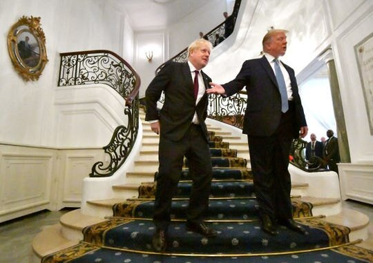 President Donald Trump and British Prime Minister Boris Johnson arrive for a bilateral meeting during the G7 summit in Biarritz, France.   (Photo: Pool, Getty Images)