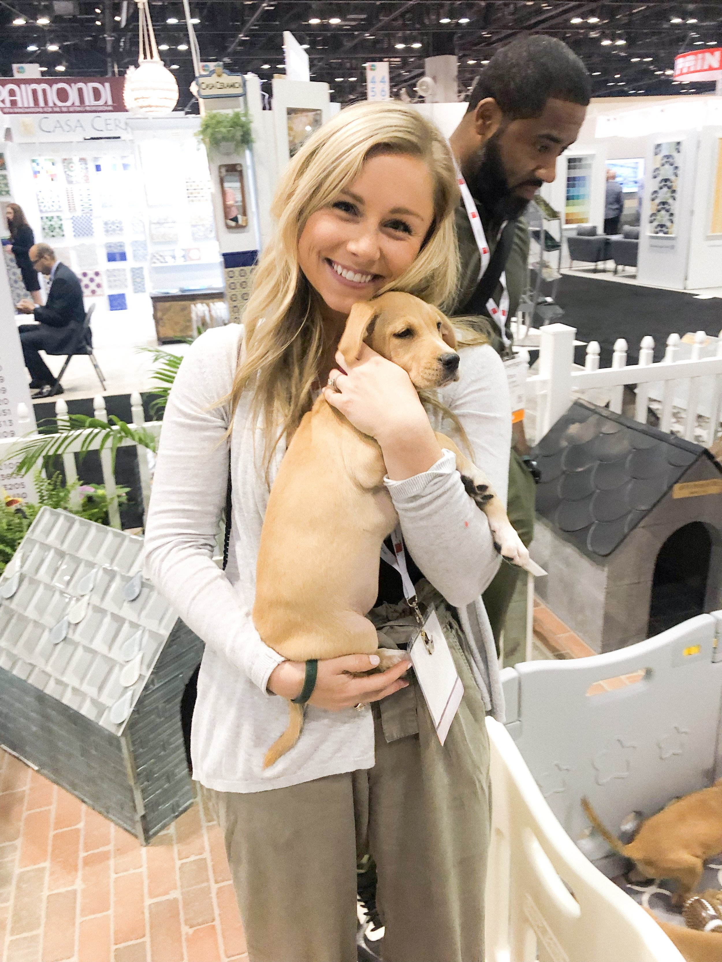 & there were puppies!! Tile Council of North America does a great exhibit every year where they have members create dog houses that will be donated to local animal shelters AND they have puppies on site that you can adopt!