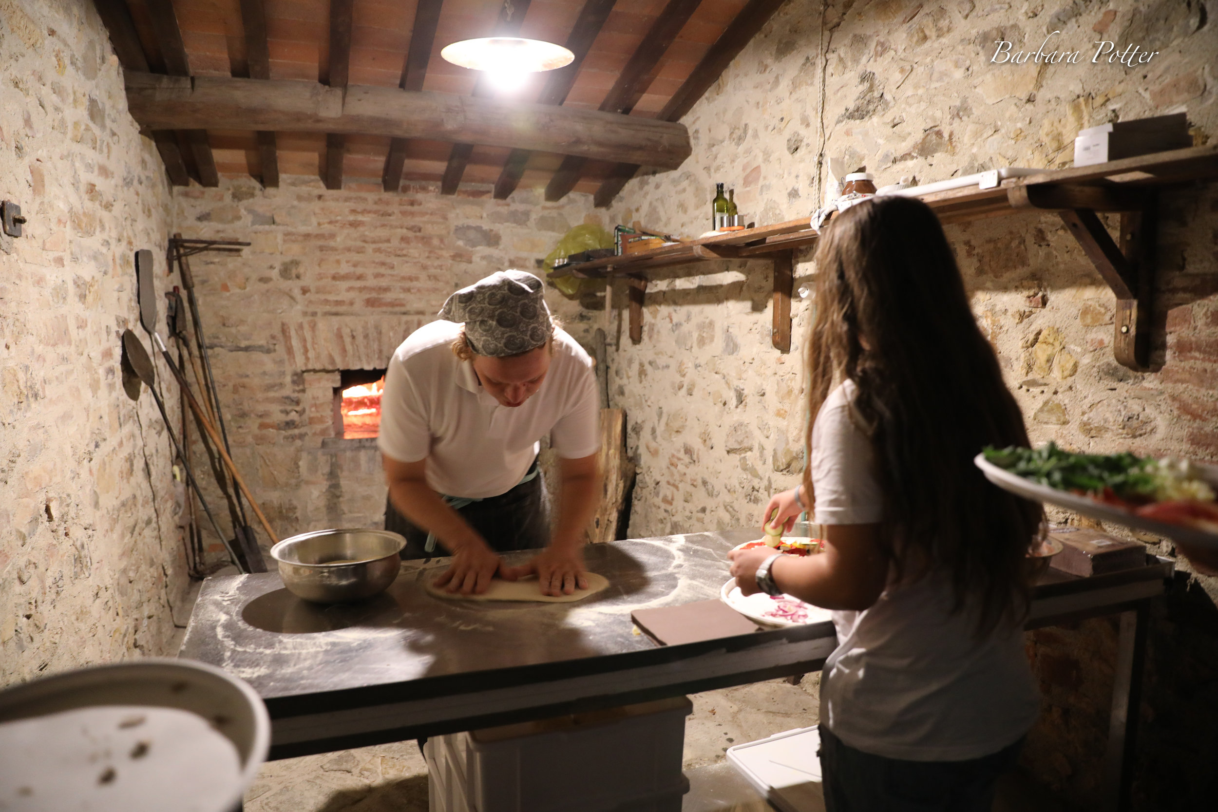Making the pizza party night 200 year old oven.jpg