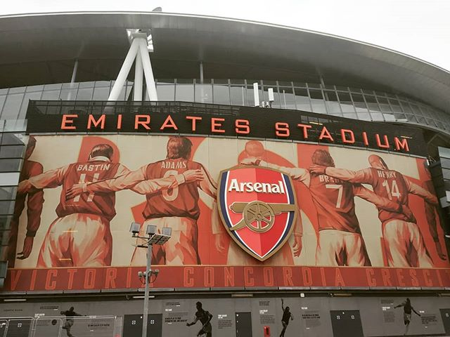 Time to kill in London + seeing a tube station that shares its name with a football team = spontaneous stadium visit. Found myself in North London today walking laps of Arsenal's Emirates Stadium, which looks pretty slick from the outside that's for sure. Clearly a club proud of it's history, statues and (giant) images of players past and present are visible everywhere, with the red and white colour scheme impossible to ignore. Premier League grounds are very curious places off season / not on a game day, with a ghostly atmosphere around the perimeter - a huge contrast to a typical mid-season Saturday with 60,000+. Did manage to catch a tiny bit of live action... flick to photo 4 for a shot of a father and son having a cheeky kick around against the stadium wall. Hoping to squeeze in a trip to Tottenham or Chelsea tomorrow, before swapping empty Premier League grounds for packed stadiums in Cairo for the final stages of the African Cup of Nations!