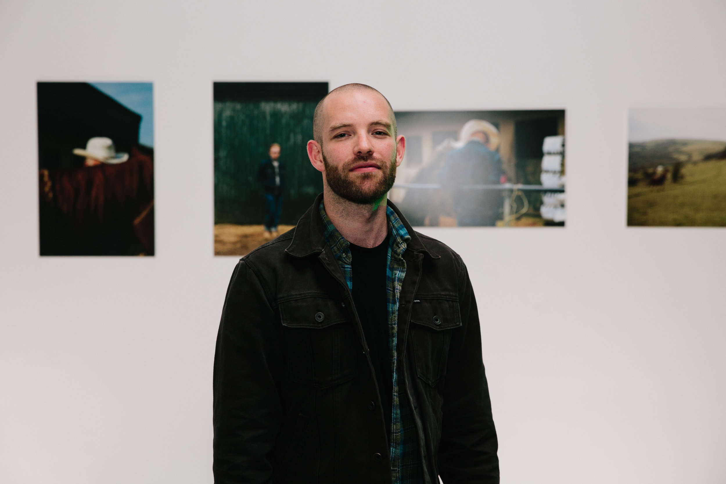 Andy in front of his images.
