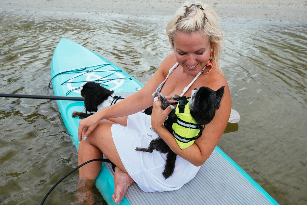 Tiffany and her boys on their daily paddle board excursion