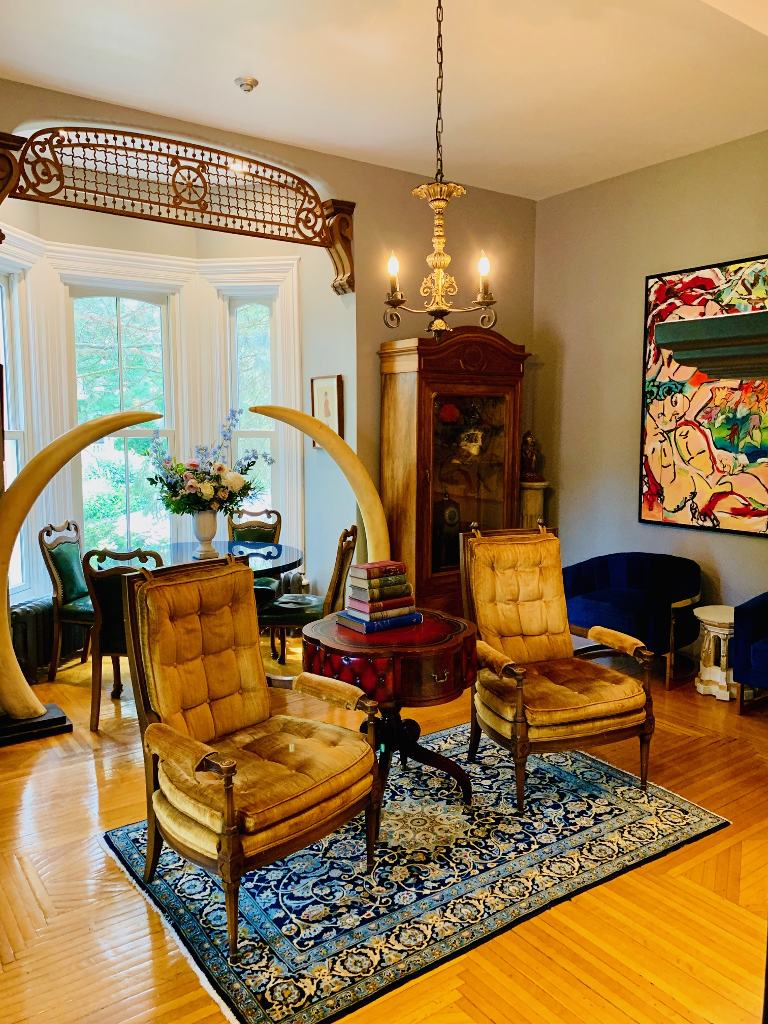 Eco-alert - the sitting room's dramatic tusks are replicas. The wonderful maple floors are (carefully restored) original.