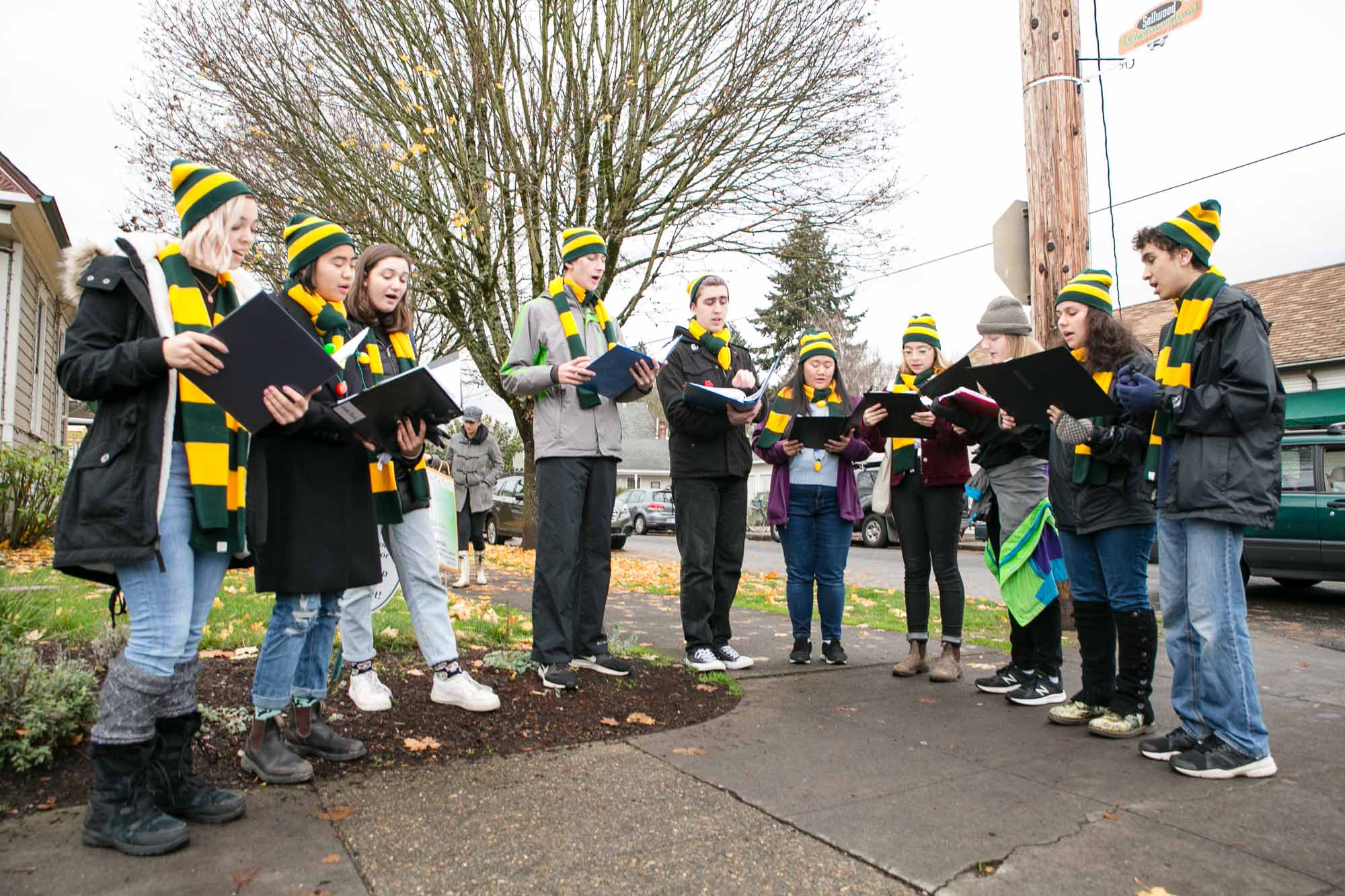 Cleveland Choir caroling for visitors of Decemberville in Sellwood.