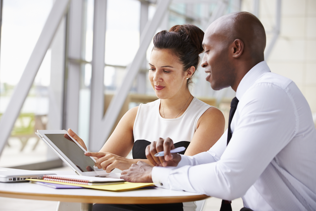 coaching_two-corporate-business-colleagues-working-together-in-office-istock_.jpg