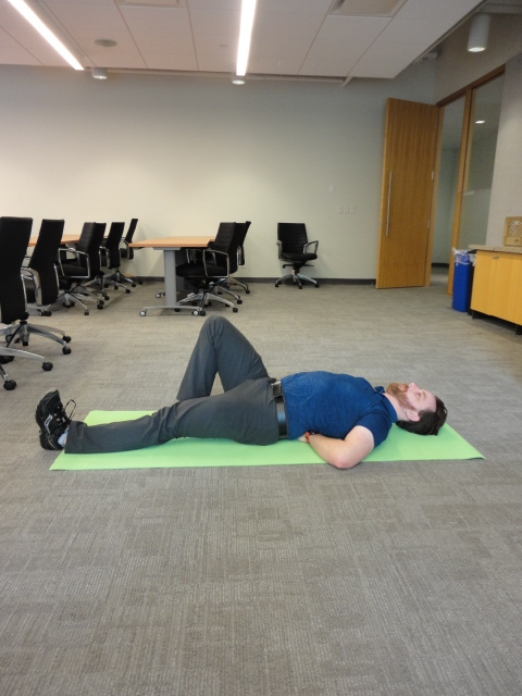 The Set up:  Lying on the ground. place your hands underneath your low back. At all time your back will be in contact with your hands.  Bring one leg up to create more support on the floor.  Tighten your core and bring your shoulder blades down and back.