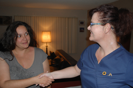 Happy_Female_Client_shakes_hands_with_Dr._Fox_after_treatment.jpg