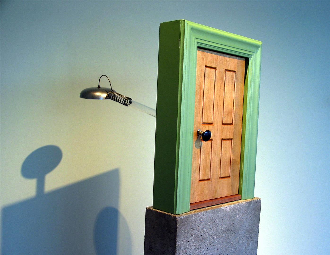 """Door Bell    wood, pinball plunger, acyrlic tube, firebell, concrete    60 x 18 15"""" / 2004"""