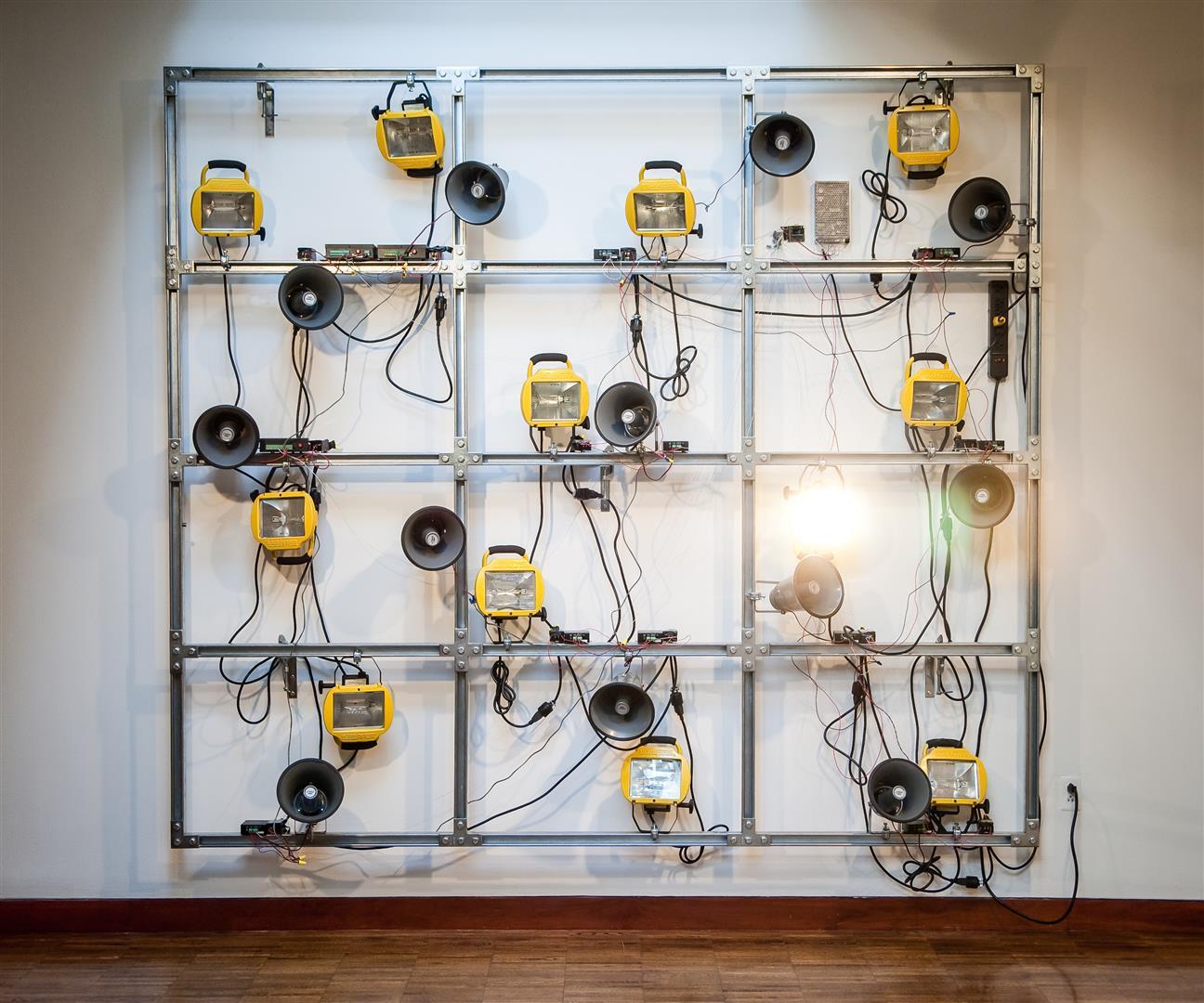 "Flashwall    Unistrut steel, electronics,media players, halogen work lights, horn loudspeakers    96½"" x 108"" x 13"" / 2012"