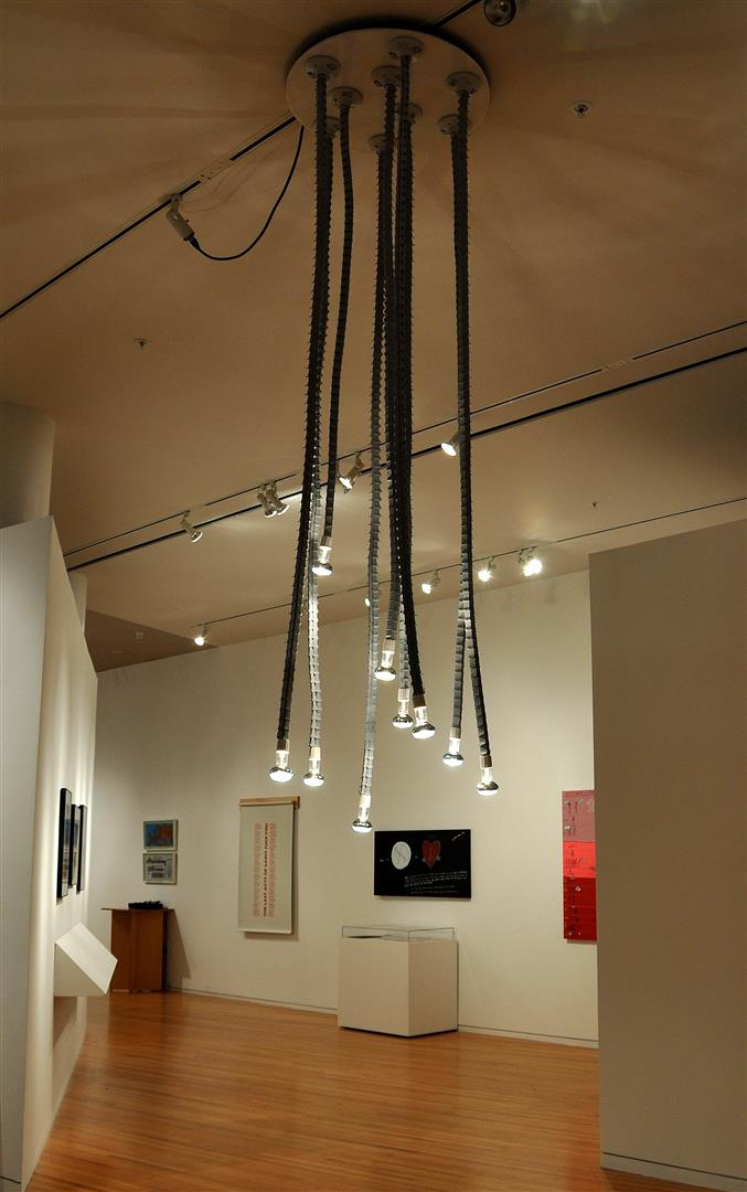 "Light Tendrils - Reed Gallery @ DAAP, University of Cincinnati, 2009 / gallery installation  three-prong/two-prong adapters, light bulbs, acrylic, bulb sockets  84"" x 30"" diameter"