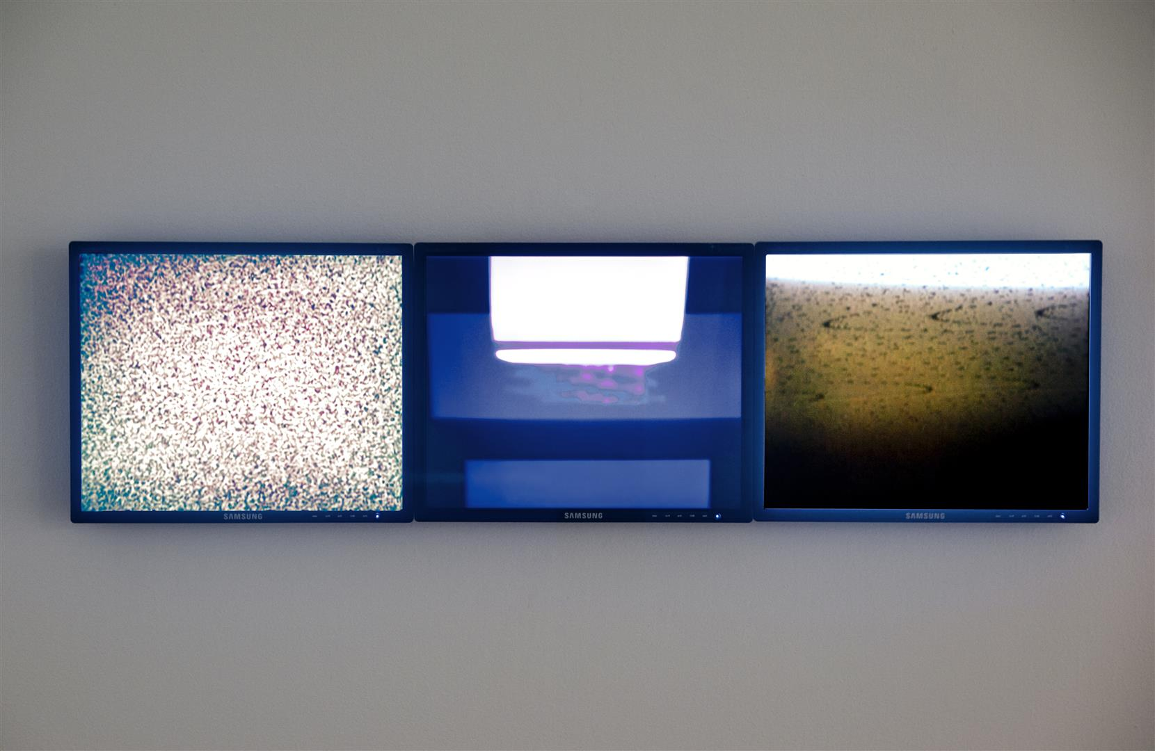 "Offing  - 3 channel video installation (no sound)  13"" x 48"" x 2¾"" overall installation  2012 / 3 media players, 3 (19"") LCD monitors"