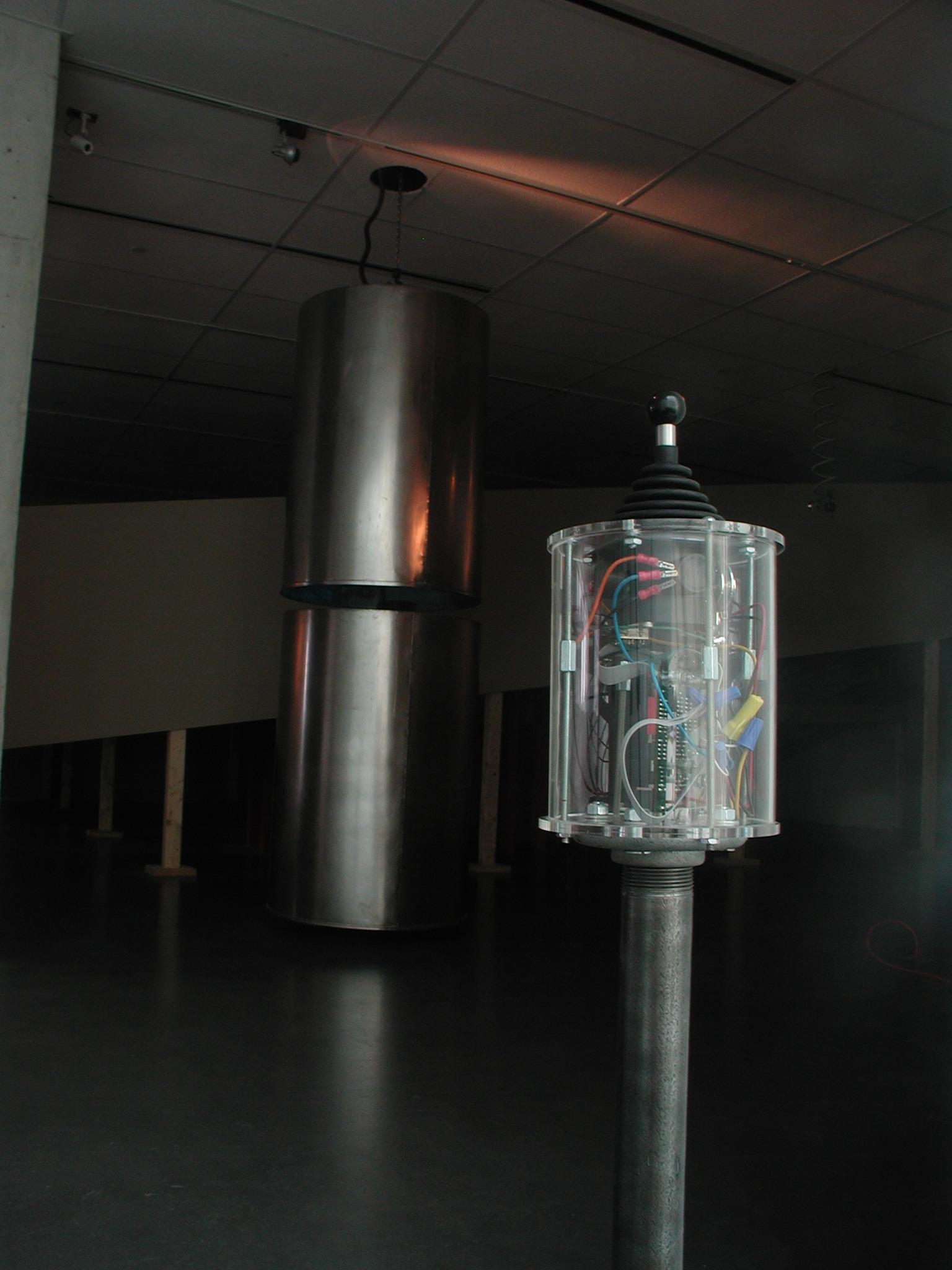 Steel Drums   stainless steel vats, subwoofer drivers, joystick, electronics, computer  4' diameter x 10' high / 2003