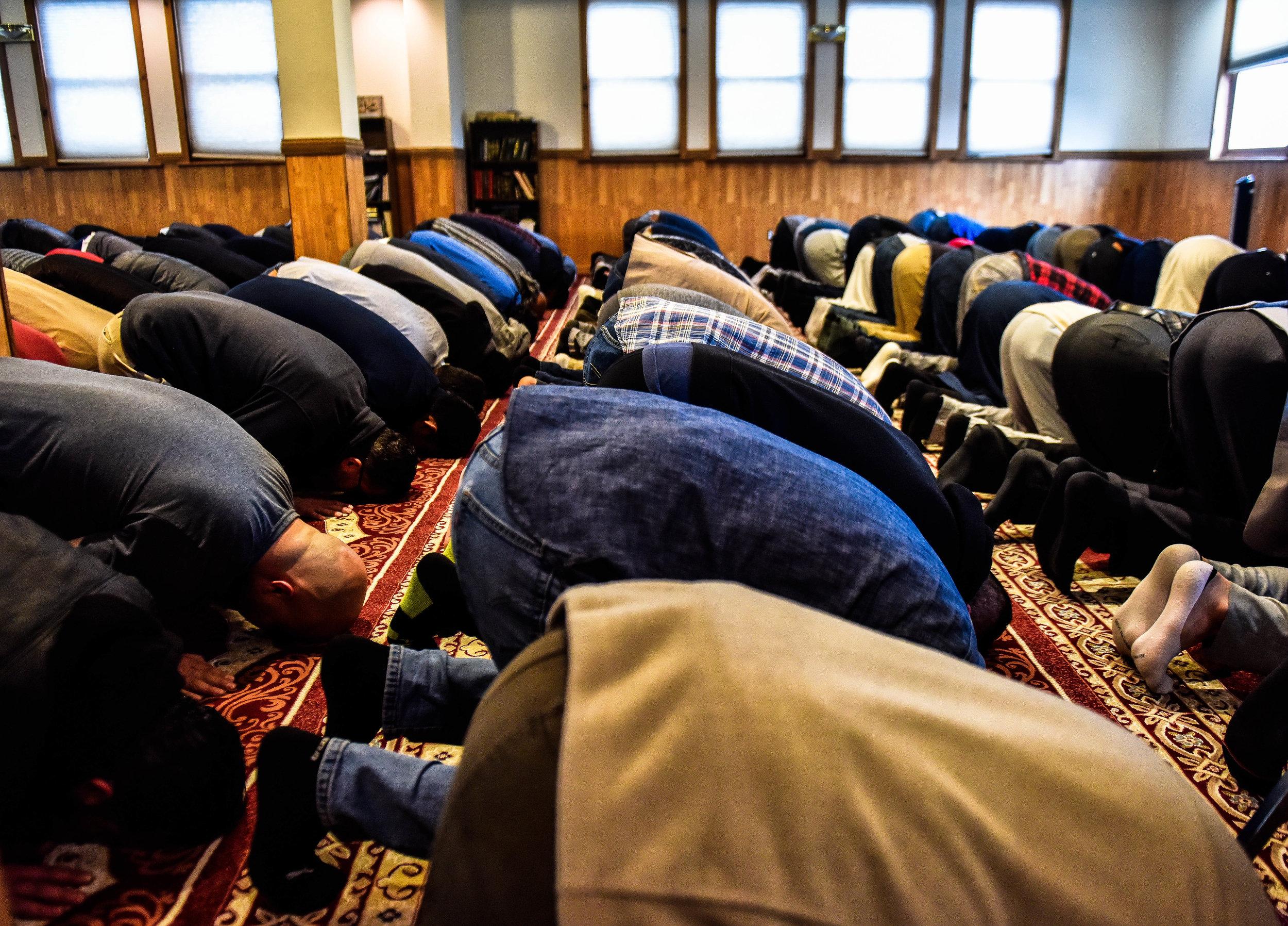 Men pray during service at Masjid Al-Noor.
