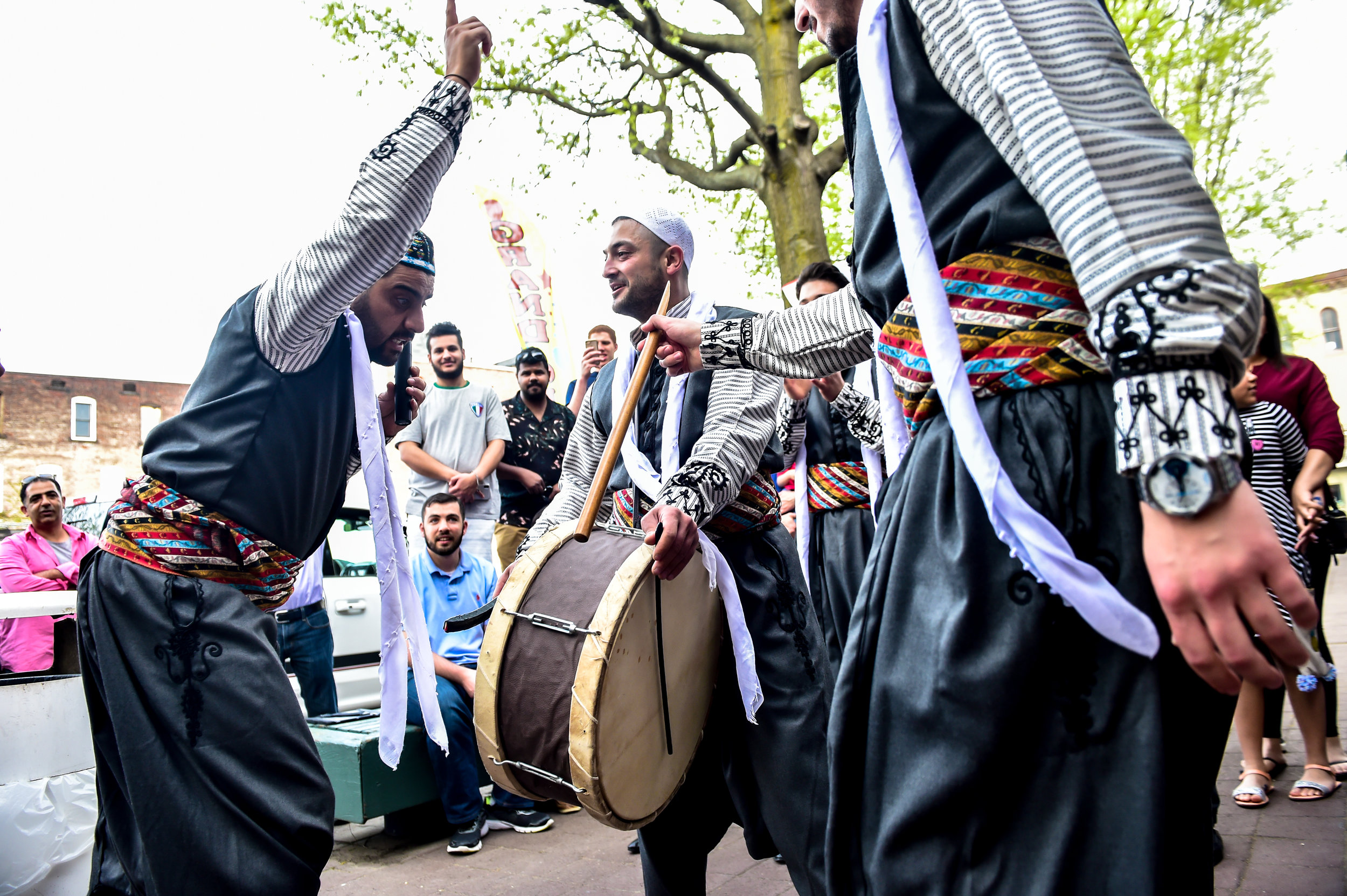 Syrian men perform music and dance during the grand opening of Tazza Shawarma and Mediterranean Grill.