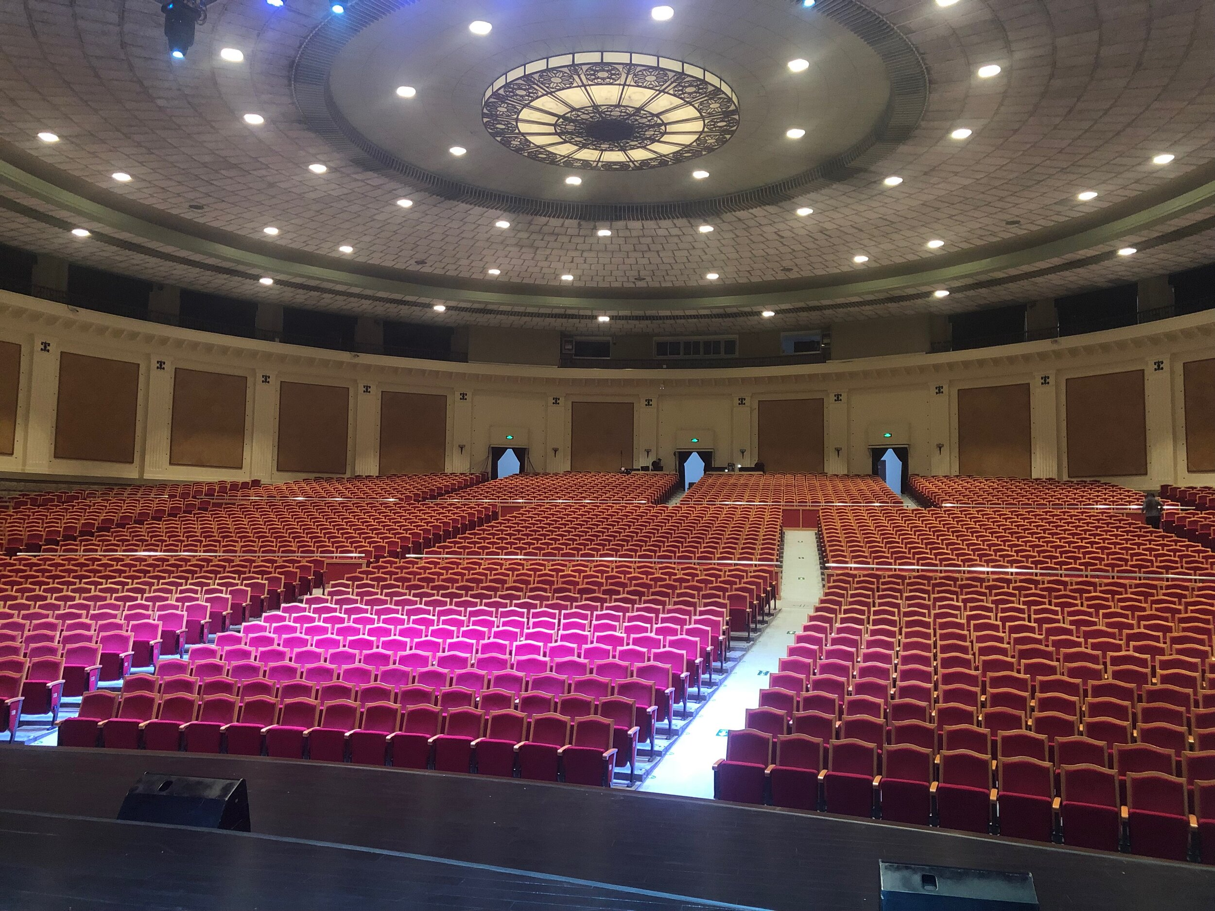 [the view from stage right at the Beijing Exhibition Center, our opening venue]