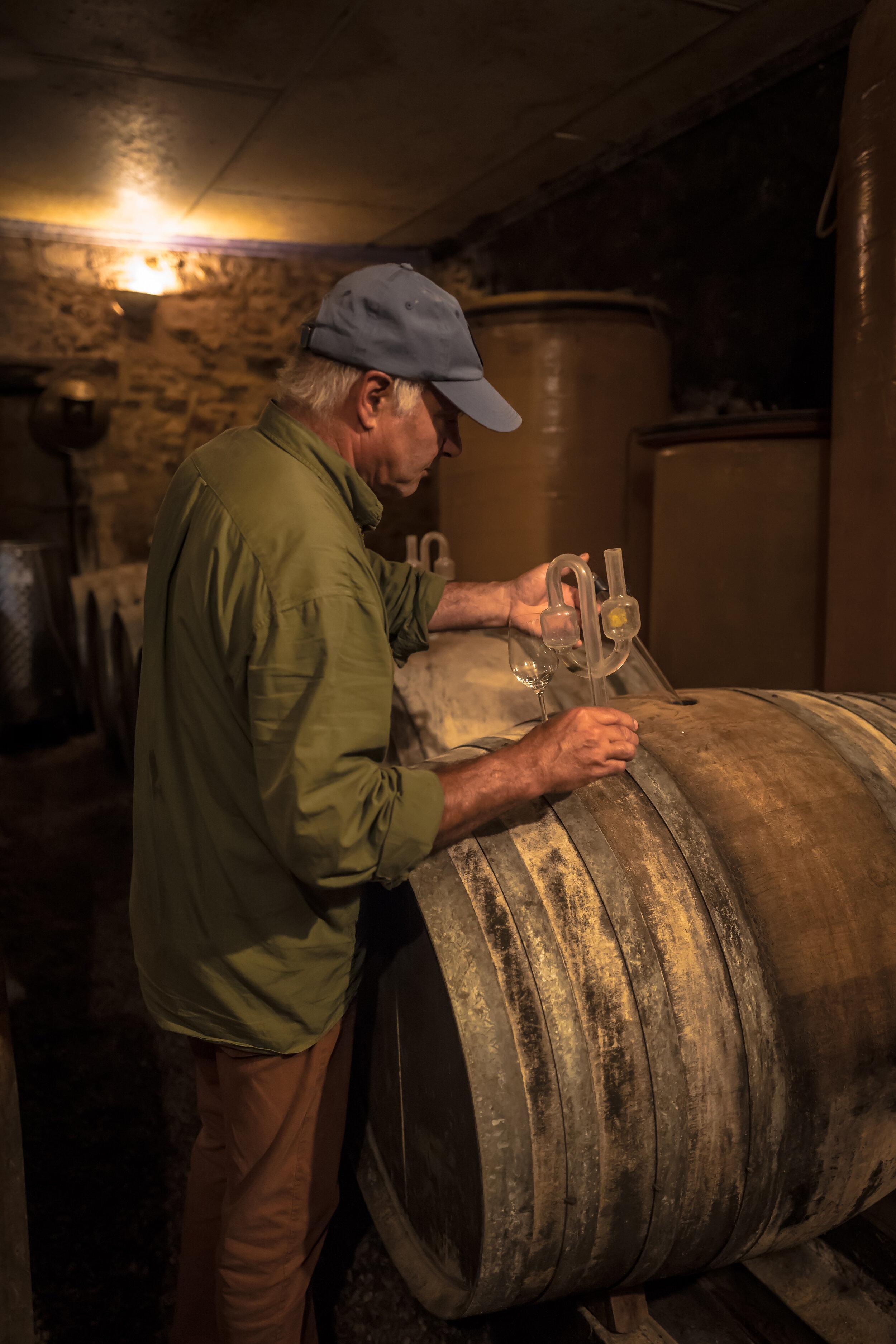 Mark Angeli taking samples from barrels