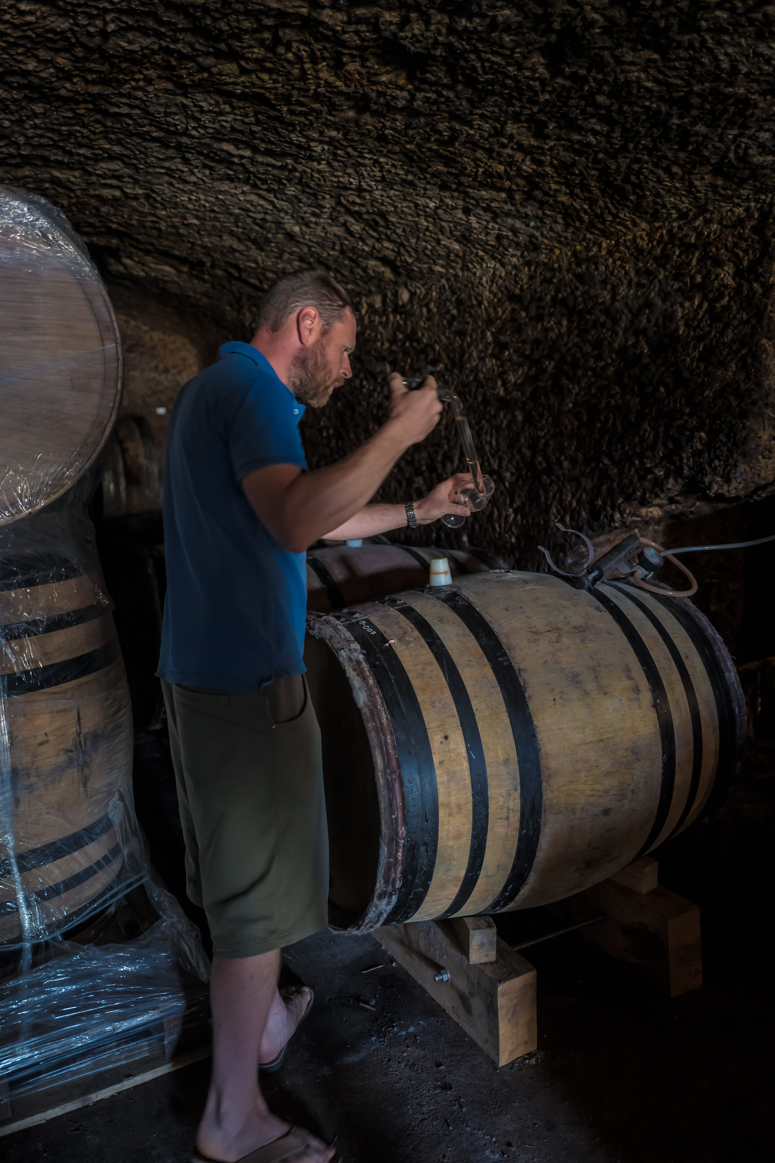 Paul-André Risse taking samples from barrels