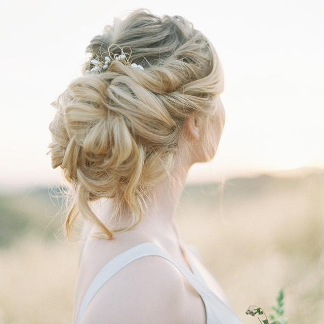 We LOVE this super romantic updo by @staceyalysonartistry! Seriously, these curls are absolutely gorgeous!  Brides, we always recommend doing a hair and makeup trial before the big day! Yes, it'll likely cost you extra but it's the perfect opportunity to try different looks and make any changes to make sure your hair and make up is on point for the big day! Your face is going to be in most of these pictures so make sure you're looking your best!  ----  Coming soon to @weddingsparrow!  Photography @mallorydawnphoto #mallorydawnmentoring Mentee @amanda.callaway Coordination @lovinglyyoursweddings Florals @plainjaneposy Hair @staceyalysonartistry  Makeup @thelookbylo Calligraphy @emilyroseink Wedding gown and Hairpiece @carolhannahbridal Bridal Shoes @bellabelleshoes Model @katelynngale Styling Surface @locustcollection Film Lab @goodmanfilmlab . . . . . #lovinglyyoursweddings #fineartweddings #romanticwedding #gardenwedding #californiawedding #weddinginspiration #weddinginspo #ocweddingplanner #laweddingplanner #sdweddingplanner #weddingseason #weddingideas #weddingplanner #weddingdesigner #loveintentionally #eventdesign #designisinthedetails #livebeautifully #darlingweekend #weddingdetails #weddinghair #weddingmakeup #bridalhair #hairstyle #updo #bridalstyle #bridalupdo 