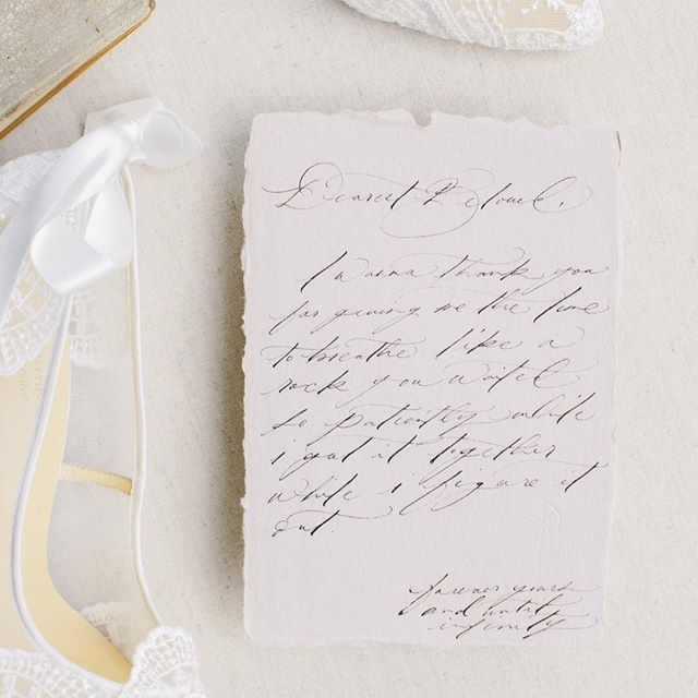 A letter written to your beloved is always such a sweet and romantic gesture. ⁠ ⁠ We always love when our couples opt to write a little something to each other to read before the festivities begin. It's so raw, so intimate, and oh so heartwarming.⁠ ⁠ Don't mind us, we'll be over here shedding a tear or two!⁠ ⁠ ----⁠ ⁠ Coming soon to @weddingsparrow⁠ ⁠ Planning & Coordination: @lovinglyyoursweddings⁠ Hair & Makeup: @kohnur⁠ Dress, Veil, & Shoes: @clairepettibone⁠ @bellabelleshoes⁠ Photography: @stevetorresphoto⁠ Design, Styling, & Florals: @bymaherharoun⁠ Venue: @catalinaviewgardens⁠ Chair & Table Rentals: @sigpartyrentals⁠ Linen Rentals: @latavolalinen⁠ Tabletop Decor: @bymaherharoun⁠ Vintage Stamps: @littlepostagehouse⁠ Paper Goods & Calligraphy: @olivesaintlily⁠ Model: @_katerinakhramova⁠ .⁠ .⁠ .⁠ .⁠ .⁠ ⁠ ⁠#lovinglyyoursweddings #fineartweddings #romanticwedding #gardenwedding #californiawedding #weddinginspiration #weddinginspo #weddingseason #weddingideas #weddingplanner #weddingdesigner #loveintentionally #eventdesign #designisinthedetails #livebeautifully #darlingweekend #weddingdetails #ocweddingplanner #laweddingplanner #sdweddingplanner⁠ ⁠#loveletter #vows #weddingvows #ido #lovestory #marriagegoals #weddingsparrow