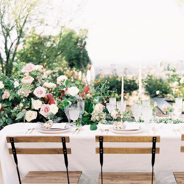 We wanted to do a little something different on this one to highlight the garden vibes of this venue. We settled on a beautiful asymmetrical piece, courtesy of the ever so talented @bloomtheorydesign, and it brought the perfect organic touches to this tablescape!⁠ ⁠ Couples, if you ever need help with designing your big day, we got your back! We offer full design services with our partial and full planning services and we can't wait to collaborate with your dream team to create original pieces and designs for a truly unique wedding!⁠ ⁠ ----⁠ ⁠ Planning, Design, & Coordination: @lovinglyyoursweddings⁠ Photography: @savanphotography #savanphotographymentorship⁠ Video: @etceteraphoto⁠ Florals: @bloomtheorydesign ⁠ Gown: @marymebridal ⁠ Suit: @stitchandtie ⁠ Hair & Make Up: @beautybespoken ⁠ Rings: @rawbyoliviamar ⁠ Venue: @foreveralwaysfarm ⁠ Tabletop: @cherishedrentals ⁠ Calligraphy: @pirouettepapercompany ⁠ Linens: @partycrushstudio ⁠ Model: @alessakayy and @andrewofbroome ⁠ ⁠ .⁠ .⁠ .⁠ .⁠ .⁠ ⁠ ⁠#lovinglyyoursweddings #fineartweddings #romanticwedding #gardenwedding #californiawedding #weddinginspiration #weddinginspo #weddingseason #weddingideas #weddingplanner #weddingdesigner #loveintentionally #eventdesign #designisinthedetails #livebeautifully #darlingweekend #weddingdetails #ocweddingplanner #laweddingplanner #sdweddingplanner⁠ #weddingday #wedding #gettingmarried #floralinspiration #floralinspo #bride #instawedding #weddingstyle #flowers⁠ ⁠