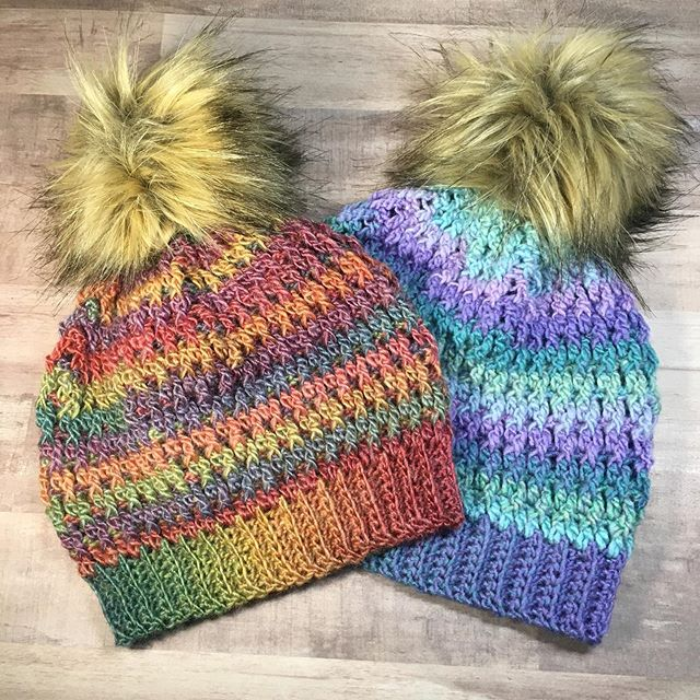 Do you prefer natural fibers like wool and cotton or artificial acrylic fibers? The rainbow hat is made with a wool blend and the same pattern and hook as the purple and blue which is acrylic, but the fabric creates is very different. It has now become a child sized slouchy hat instead of a fitted adult small/medium. So funny how that works. Especially since my personal crochet tension is almost always the same now. This #winterseabeanie pattern will be released on September 20th! The adult small/medium size will be for free on my website! Free is the best price after all. 😊😉 Both of these beautiful hats will be available at @stillwaterlibraryok this weekend for their yearly Comic-Con #stillwaterlexicon !! @tonias.totes and I are really excited to join them again this year! •• #rainbow #hat #pompom #fauxfur #handmadeisbetter #custommade #newpattern #freepattern