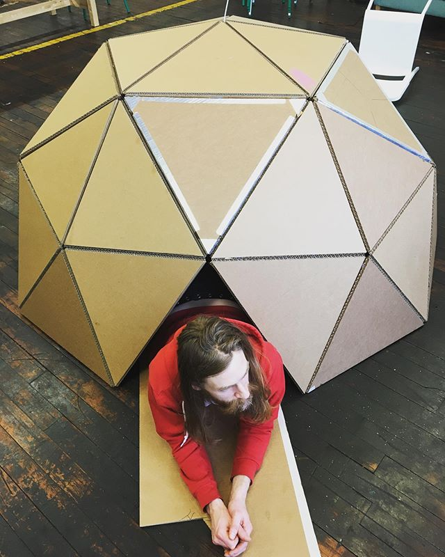 A man and his dome! After countless hours of measuring and cutting, glueing and taping, the dome is complete! Next, a skirt to elevate it up for easier entry. #buckydome #fortfuture #making #cardboard
