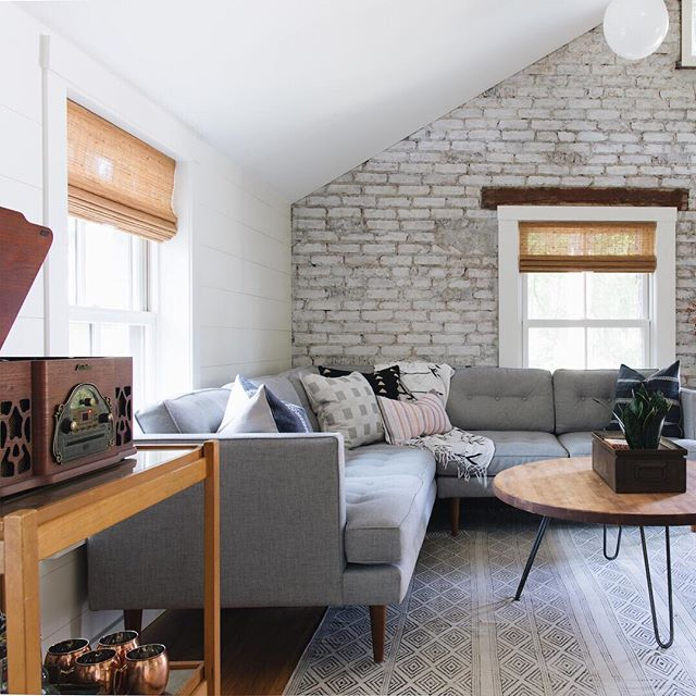What album can you listen to over and over? This cozy Coach House is the place to curl up and enjoy side A and B. | 📷 @stofferphotographyinteriors  #hogankellydesign #coachhouse #recordplayer #exposedbrick #shiplap