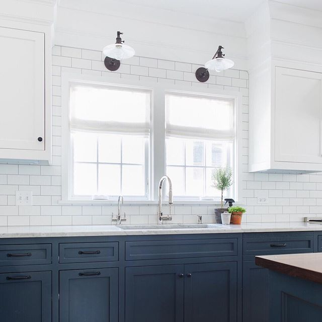 Doing some meal planning and daydreaming about this bright white and blue kitchen we did a few years ago. Still love those milk glass sconces. Are you cooking up a storm or ordering in? 🤔 | 📷 @stofferphotographyinteriors #hogankellydesign #ontheball #kitchendesign #whitesubwaytile #schoolhouseelectric
