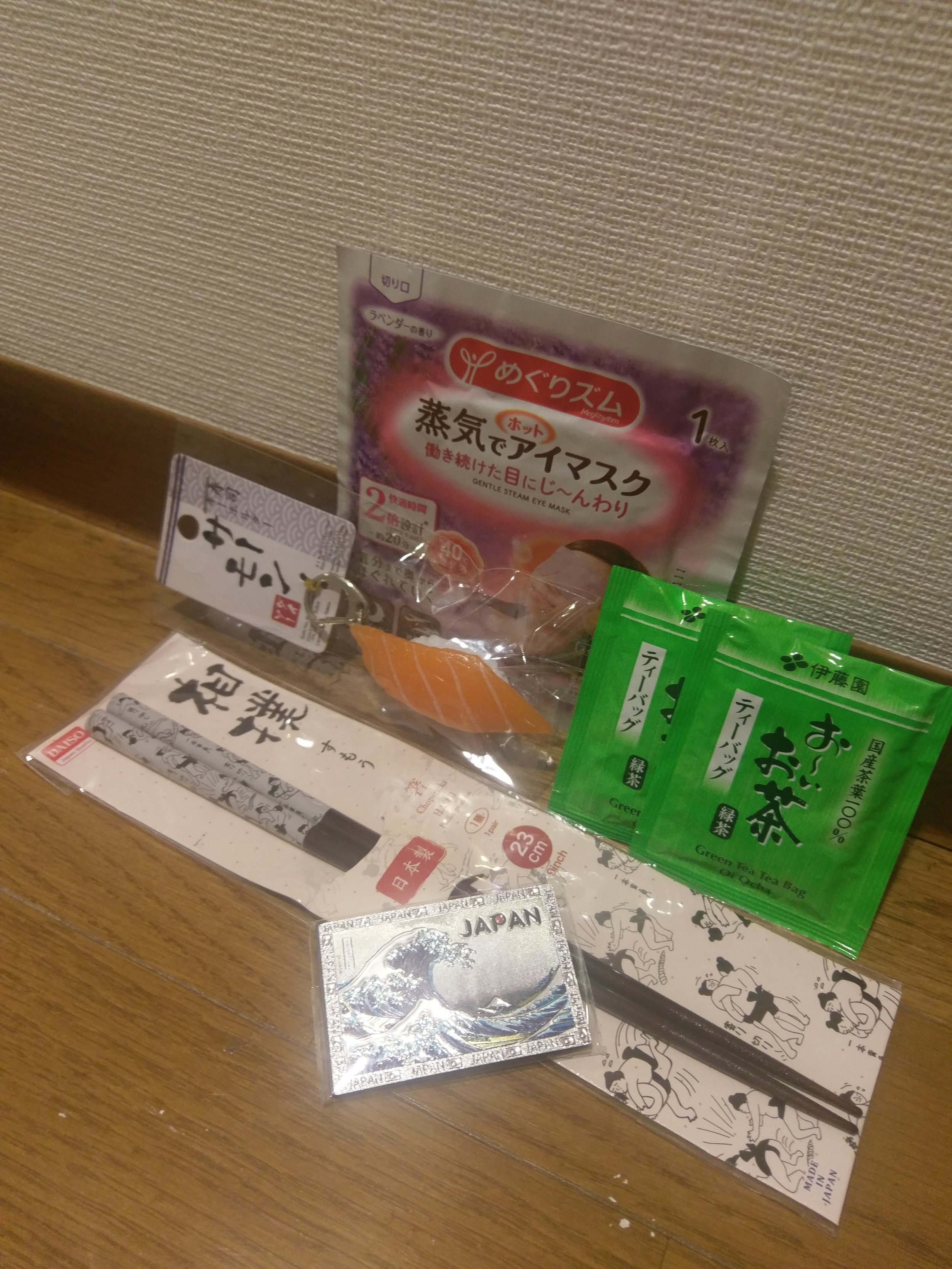 A lavender-scented heated eye mask and green tea bags (supermarket), a sushi keychain and chopsticks with  sumo s on them (Daiso), and a magnet with the famous Hokusai artwork (somewhere in Teramachi)