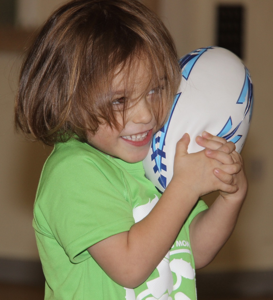 Rafferty loves a rugby ball.jpg
