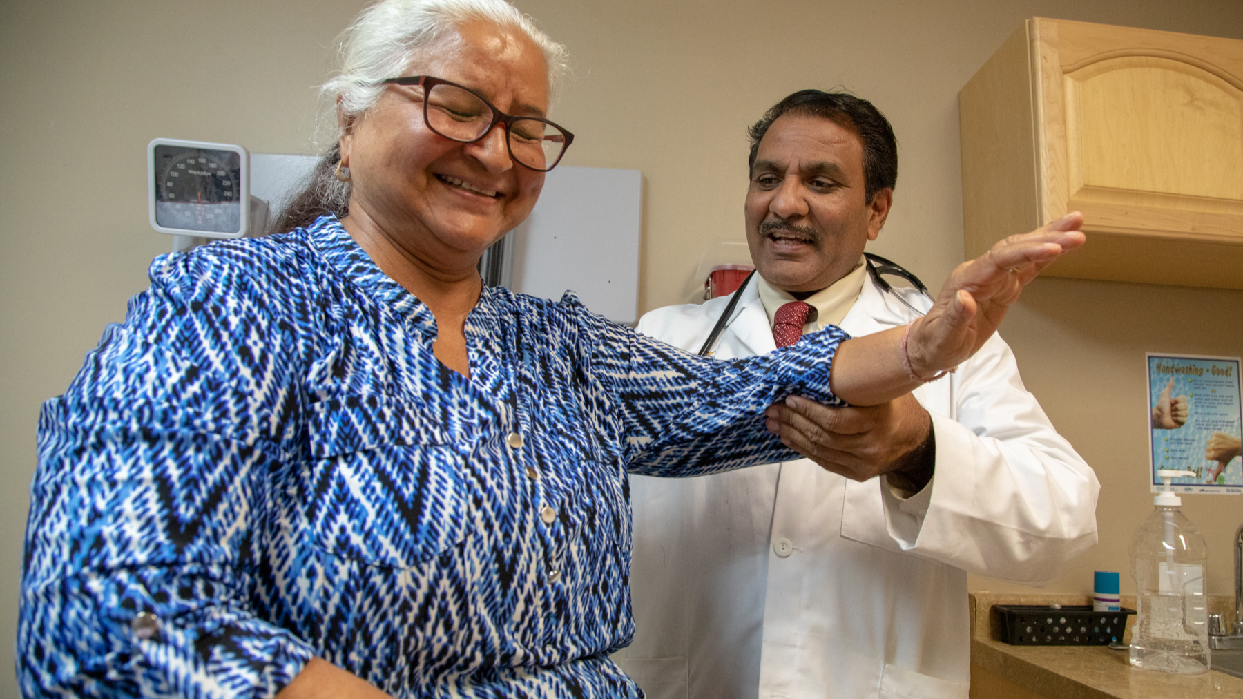 MAVEN Provider Dr. Quereshi Works with a Patient at UHI Clinic
