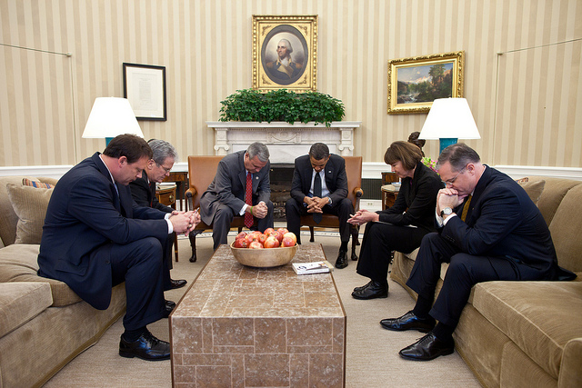 Prayer circles like this one in the Oval Office were common events during the Obama, Bush, and Clinton presidencies. Photo Credit: The White House (Pete Souza)