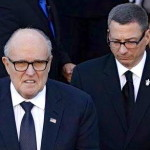 With former NY mayor Rudy Giuliani at the funeral of slain NYPD officer Rafael Ramos. Should the guy that killed him have had access to a gun?