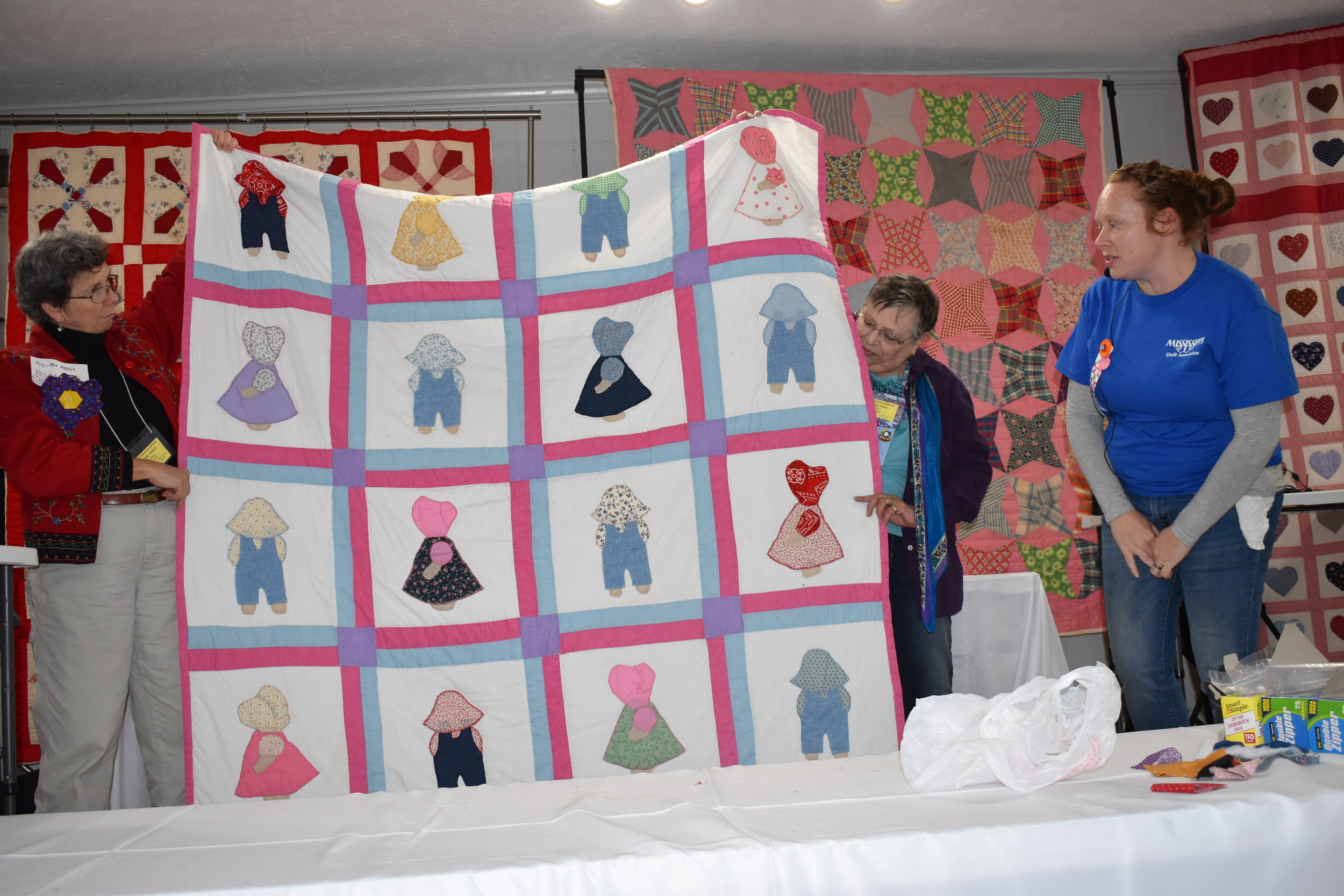 - Tracy Jackson shows some of Louise Hatchers' quilts.