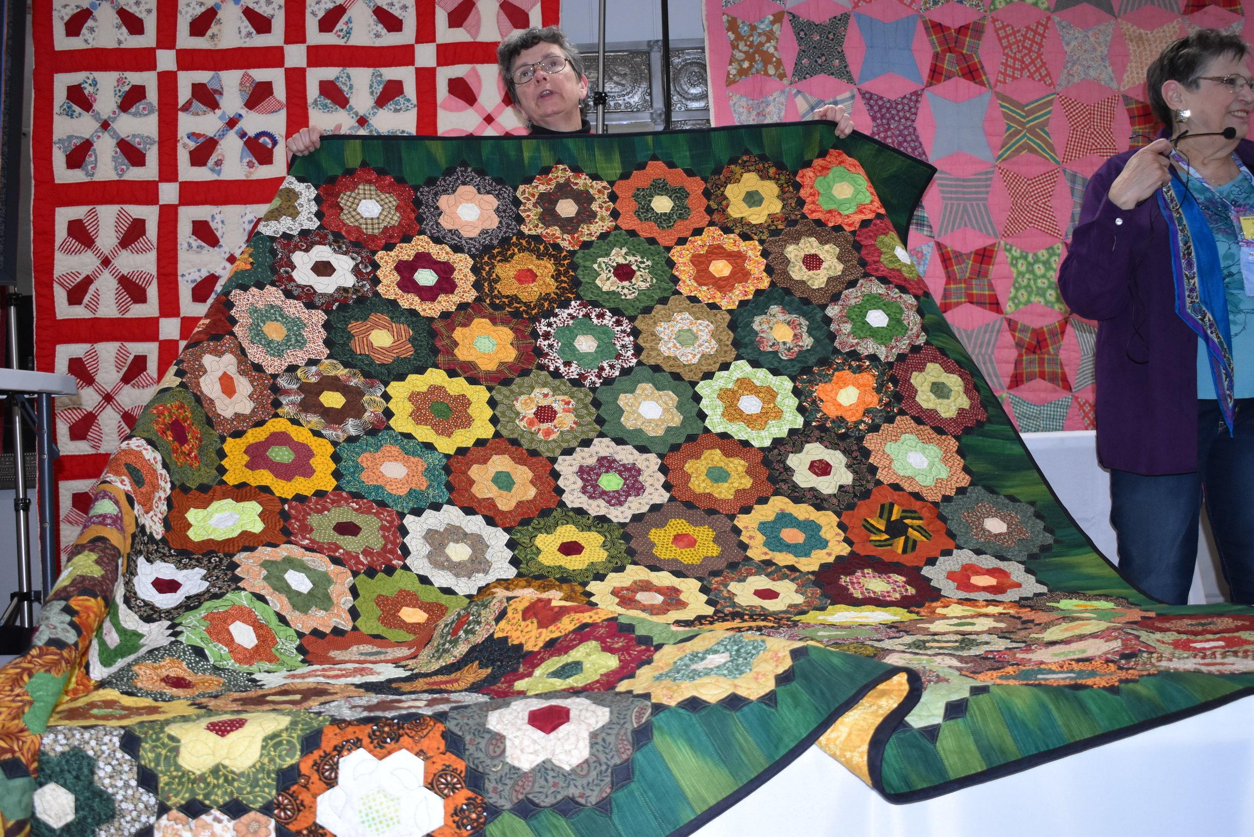 - Nancy Losure showed her machine pieced hexagon quilt. She teaches workshops on this technique.