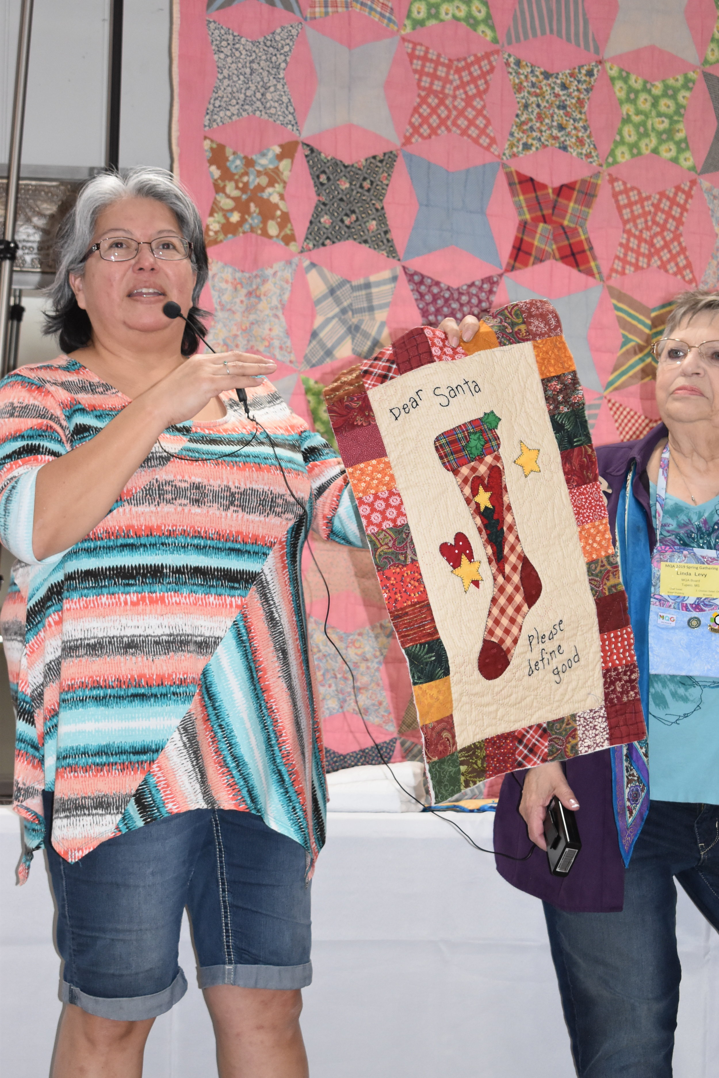 - Naomi Perry shows her Mountain Quiltfest challenge quilt.