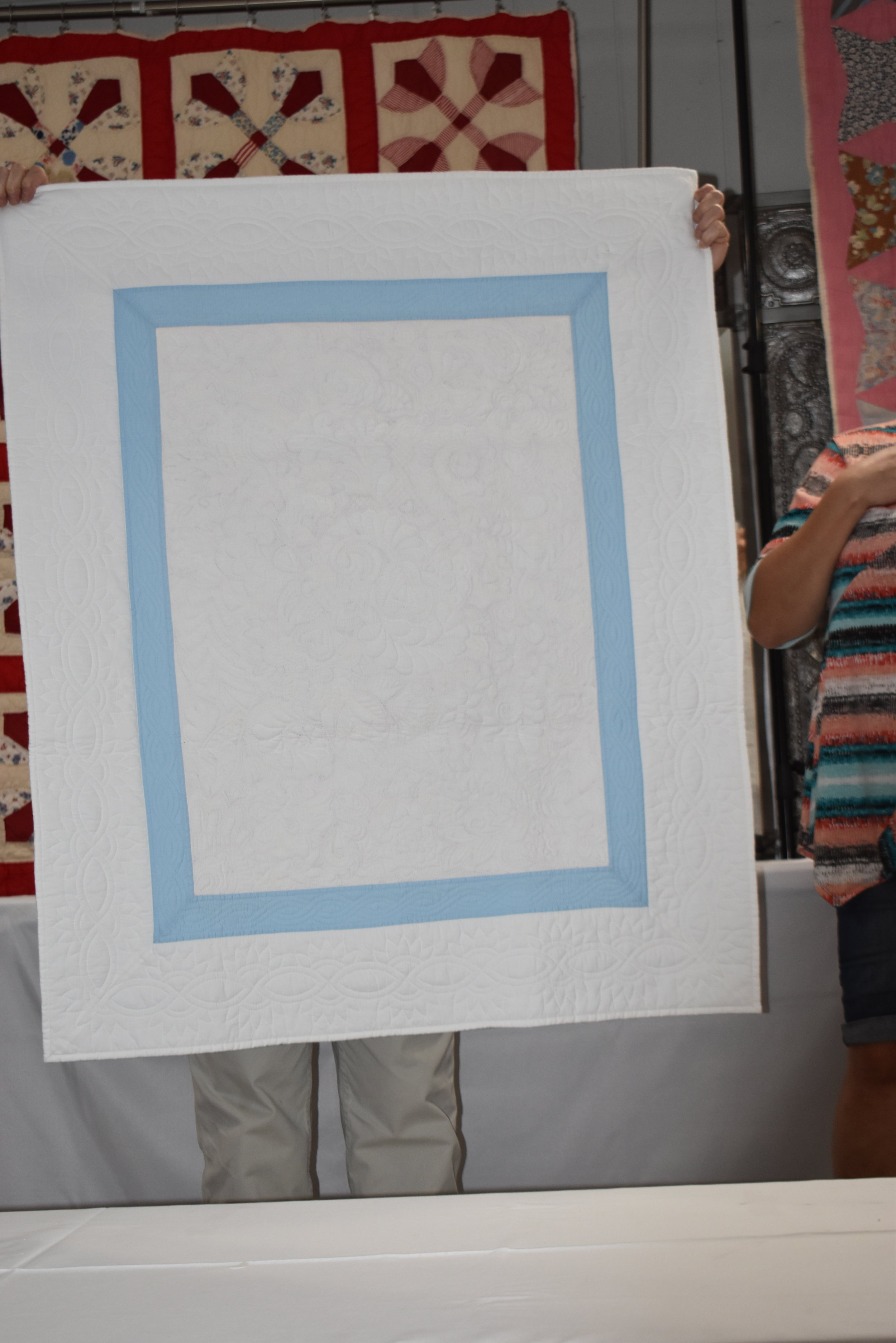 - Naomi also showed this hand quilted free motion baby quilt or wall hanging