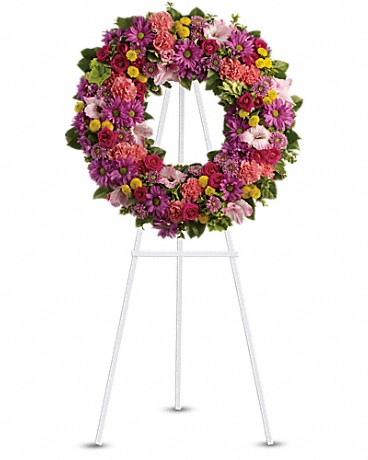 Ringed By Love    A standing wreath of dazzling flowers such as green hydrangea, hot pink spray roses, pink gladioli and carnations along with a mélange of multi-colored daisy spray and cushion spray chrysanthemums and greenery is delivered on an easel.    Shop Now>>