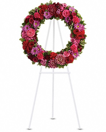 Infinite Love    Dazzling blooms such as pink hydrangea, hot pink roses and carnations, red roses, spray roses and carnations, burgundy dahlias, dark pink Sweet William, lavender daisy and button spray chrysanthemums along with fern and other fresh greens create a beautiful wreath that comes delivered on an easel.      Shop Now>>