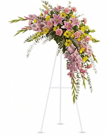 Sweet Solace    Lilies, gladioli and chrysanthemums - that has hints of eucalyptus and variegated greens. Stems of flowers such as pink lilies, gladioli and carnations with yellow snapdragons, and daisy spray mums, accented by variegated greens and eucalyptus.    Shop Now>>