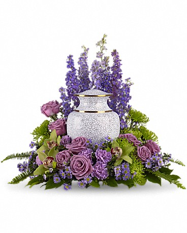 Meadows of Memories    Soft lavender and green blooms to surround the urn, like a peaceful, contemplative garden. A subdued assortment of flowers such as lavender larkspur, roses and asters are grouped beautifully with the rich greens of cymbidium orchids, chrysanthemums, English boxwood and sword fern.    Shop Now>>
