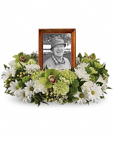Garden Wreath    An exquisite round wreath with blooms inspired by the lasting impressions a loved one makes on our lives. This luxurious wreath includes flowers such as carnations, chrysanthemums, silky green cymbidium orchid blossoms and variegated greenery. Please note: Arrangement does not include picture frame.    Shop Now>>