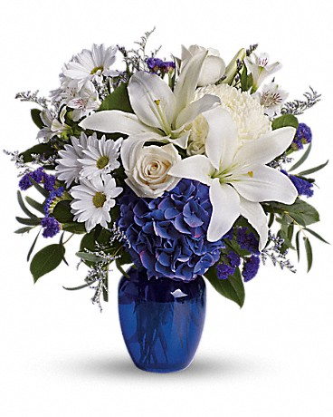 Beautiful In Blue    The serenity of the color blue along with the purity of intention symbolized by white will let the family know you are sending your calm strength to them during these difficult times. Blue hydrangea, crème roses, white lilies and alstroemeria along with yellow and white chrysanthemums, eucalyptus, limonium.    Buy Now>>