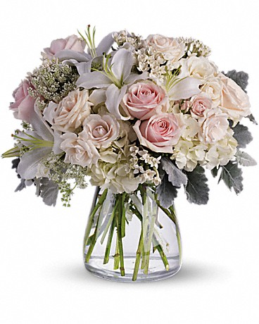 Beautiful Whisper    A whisper-quiet affirmation of love. Subtle shadings of pink and white roses, lilies and delicate Queen Anne's lace in a simple, elegant vase. Gorgeous flowers such as white, crème and light pink roses, white oriental lilies and delicate Queen Anne's lace with a touch of silvery dusty miller, all in a classic hurricane vase.    Buy Now>>