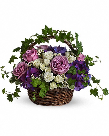 A Full Life    Even in mourning it is important to remember and honor a life well lived. This beautiful basket of purple and white flowers blended with vibrant greenery is a wonderful way to pay tribute to one who has indeed lived a full life. Brilliant flowers such as purple hydrangea, lavender roses, white spray roses and waxflower are arranged with beautiful ivy and more in a lovely round basket.    Buy Now>>