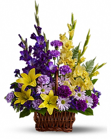 Basket of Memories    Honor rich remembrances of one dearly missed with a vivid mix of blooms that offer strength and comfort alike during a time of sorrow. Yellow asiatic lilies and gladioli contrast with purple carnations, statice and gladioli, lavender carnations and chrysanthemums in a rectangular basket with handle.    Buy Now>>