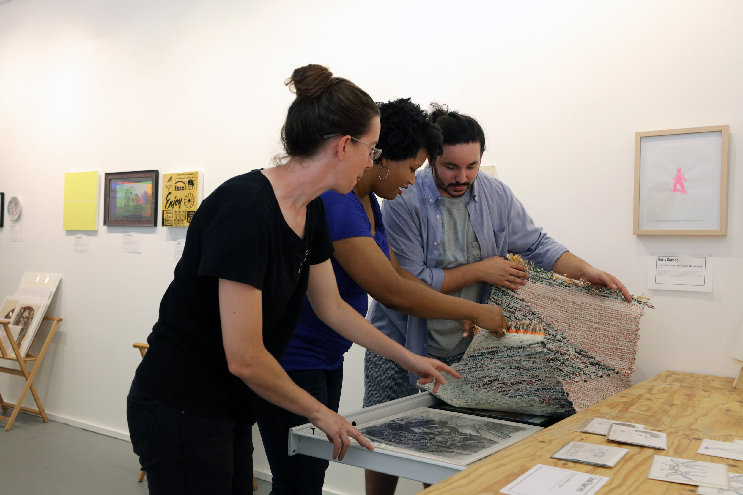 Co-Director Emma Wilcox, Gallery Manager Candace Nicholson, and Registrar Juno Zago  | Photo Credit: Anthony Alvarez