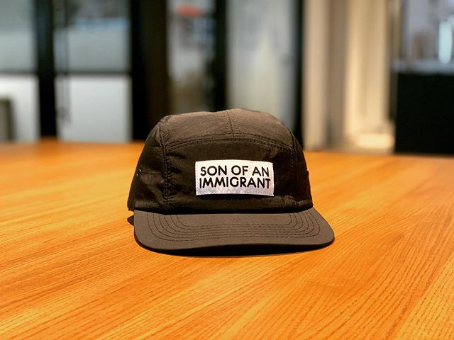 When I saw this hat being worn by one of the artists at @theotherartfair in Brooklyn this past weekend, I was instantly on a mission. @vidhyan told me that @miscelaneany had these @sonofanimmigrantny hats, so we b-lined it over there. Anyone who immigrates to a new country is brave, hardworking, resolute, & driven. I'm proud of what my father and many others have done in this country - contribute & dream big... on behalf of their family, and to honor the opportunity they were given. Adelante! #sonofanimmigrant #daughterofanimmigrant #immigration #immigrants #hardwork #dedication #bravery #selflessness